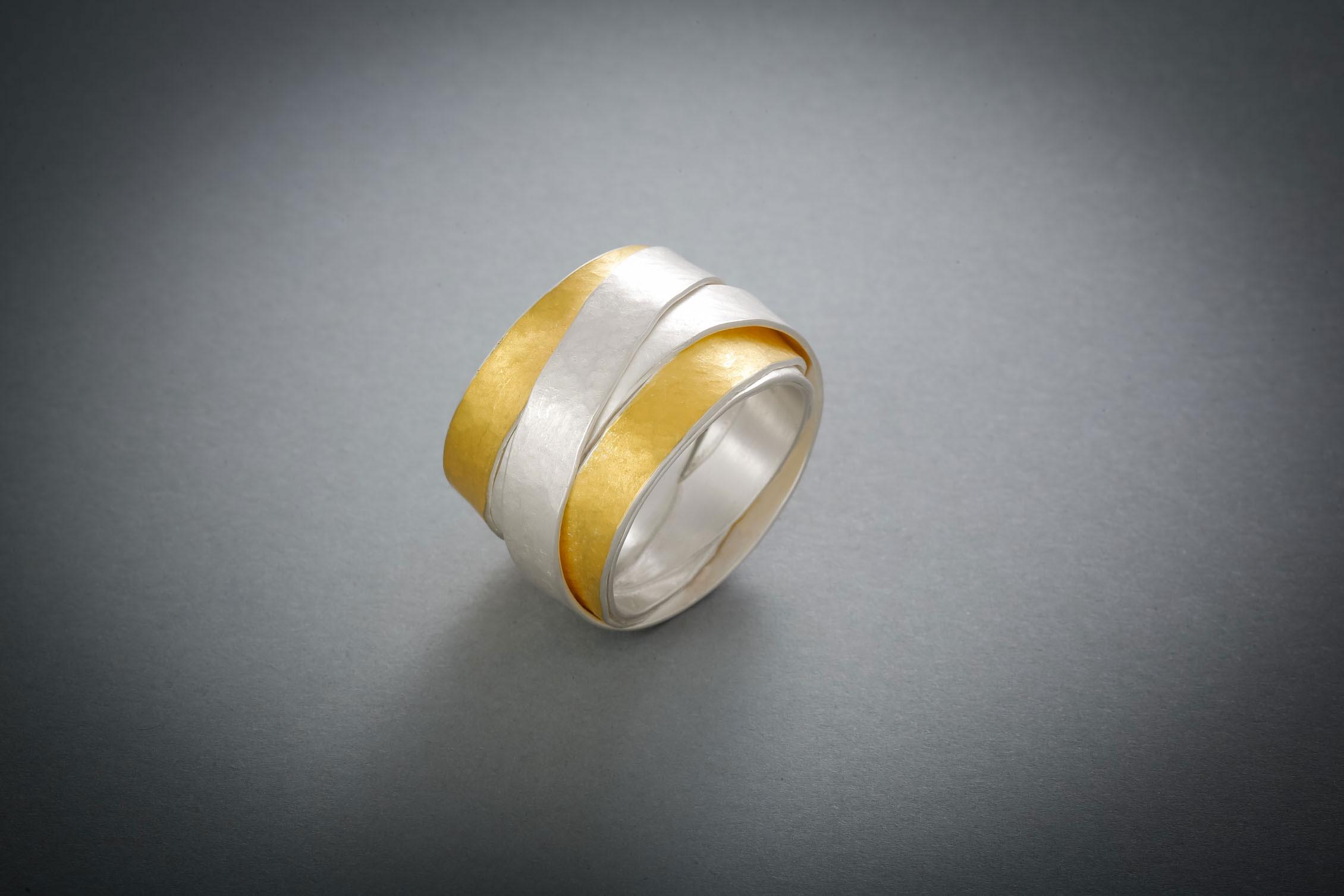 011 Wickelring, Silber teils mit Feingold belötet, ab € 490,-